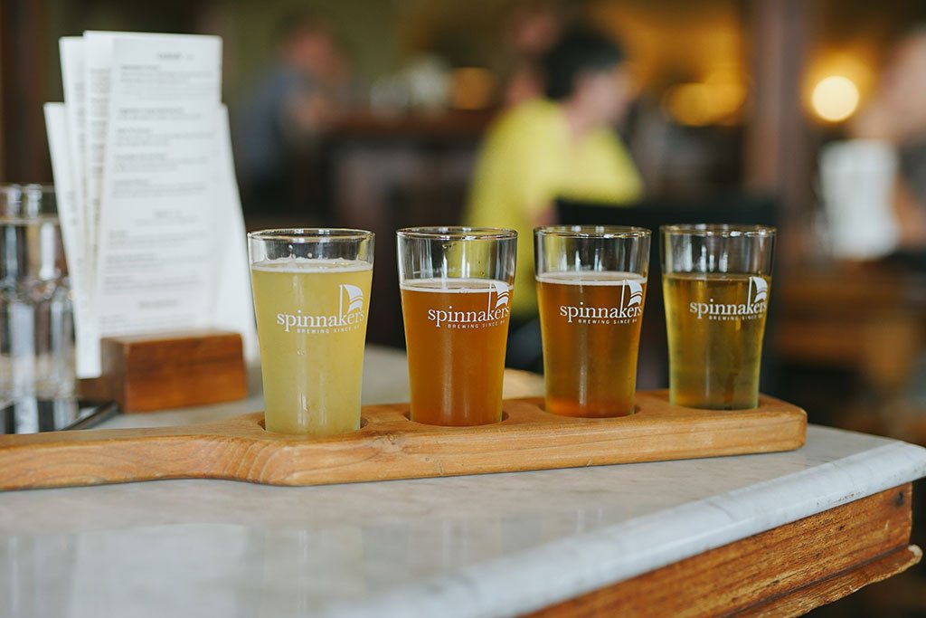 Kick back with a tasting flight of frothy pints at Spinnakers Gastro Brewpub. Credit: Nick Bentley